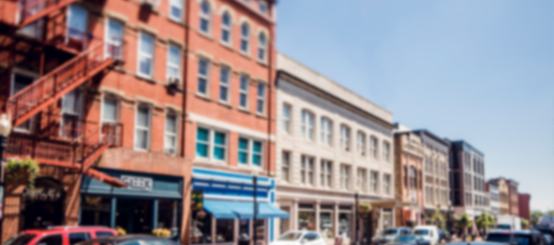 blurred background of a side street in downtown Louisville